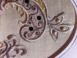 Further detail of added pearls to lace
